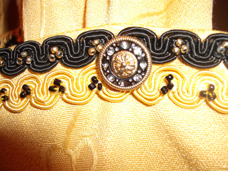The braid and beads on the tippet cuff - this is the same braid as on the black velvet surcoat edges