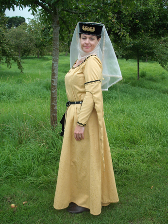 Yellow brocade dress with tippets