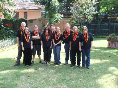 The Huddersfield North team in the grounds of the hotel with our welcome marigold garlands