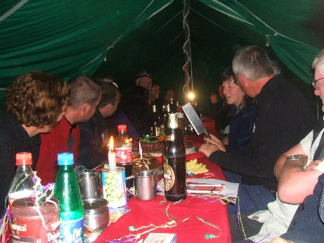 Evening entertainment in the mess tent playing cards and Pass the Pig and having quizzes