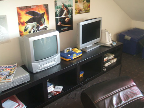 Jake's gaming area - Ninento 64 on one tv Nintendo Wii on the other and one of thsoe cool rocker chairs
