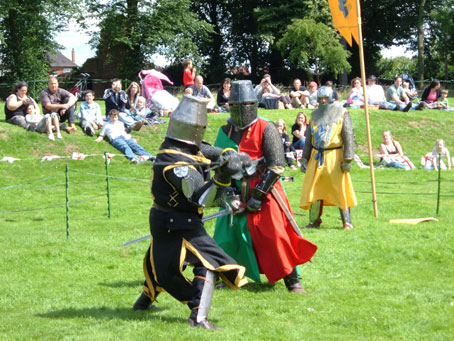 During a show at Asby Castle - De Graily in black, Cameron in red and green and Percy in yellow and blue