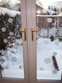 The doors out to the garden with snowflake motifs