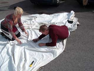 Bev and Dave doing a bit of tent mending