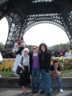 Mum and kids under the Eiffel Tower