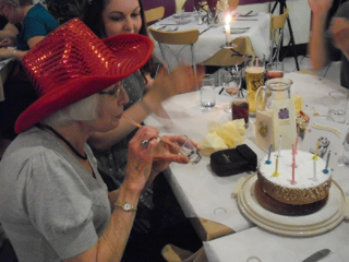 Mum and her birthday cake and shot of sambucca