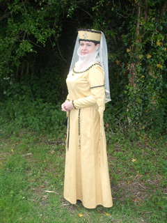 Me in my gold dress and torque headdress