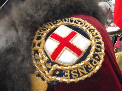 The Order of the Garter emblem on his cloak