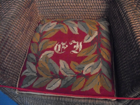 The needlepoint cushion on Edward Jenner's garden chair - in the middle are his intials