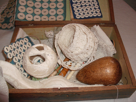 The sewing box from the attic complete with darning egg and buttons!