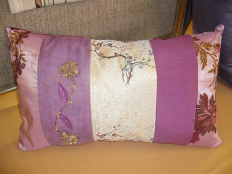 A cushion with embroidery and beading