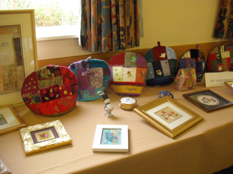 Crazy patchwork tea cosies made at one of the day schools