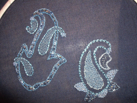 The finished piece still in its hoop - two Paisley inspired motifs