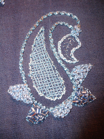 Stitches used - couching, running stitch, chain stitch and lattice