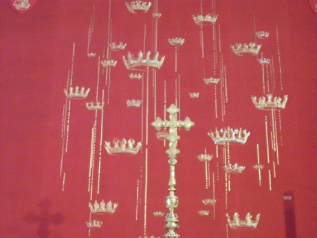 A goldwork hanging of crowns