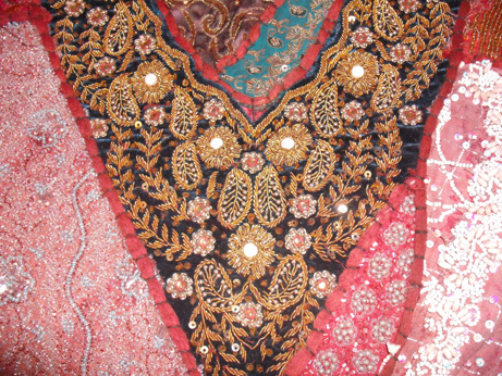Detail of the wonderful goldwork in the centre of the hanging