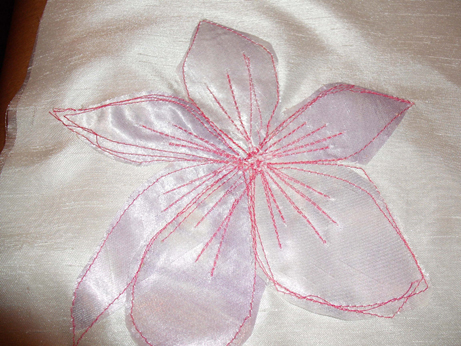 The appliqued flower with machined detail