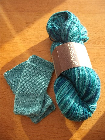 Aqua handwarmers and wool