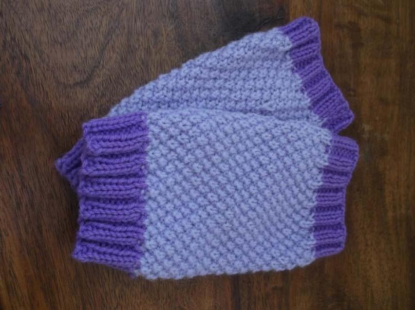 Ellie's purple wristwarmers