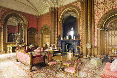 The Drawing Room at Penrhyn Castle, Gwynedd showing the oak chairs and sofa designed by Thomas Hopper and the dazzling silk lampas (brocade) and curtains