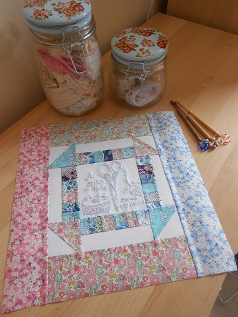 Churn dash and embroidery block 1