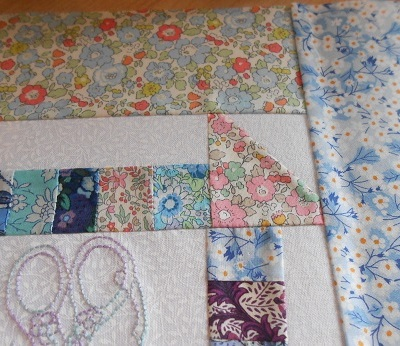 Churn dash and embroidery block 2