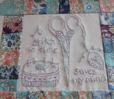 Churn dash and embroidery block 3